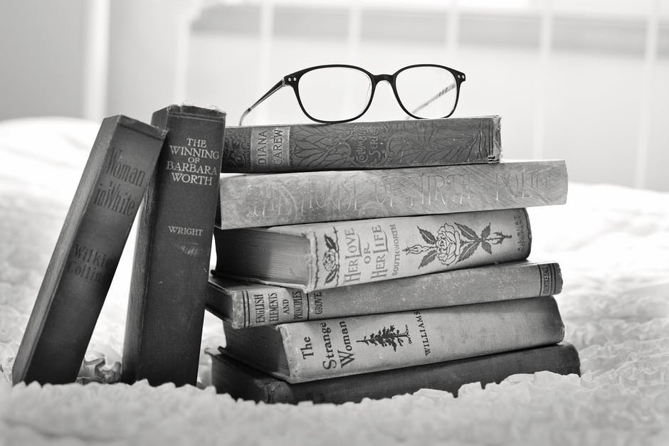 old books and round glasses